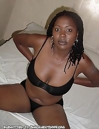 Ebony chick gets naked in a hotel room