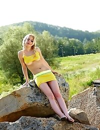 In No Time Blonde Teen Gets Rid Of Her Clothes And Goes On With Posing Naked On The Stones.