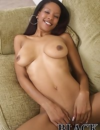 Sexy big tit black babe spreads her pussy lips to show some pink