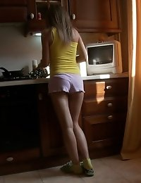Horny Teenie Gets Pleasure In The Kitchen, Where She Fucks Her Wet Pussy After Hot Strip In Front Of