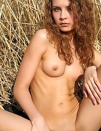 Her Blonde Curly Hair Matches Wit The Background As She Is Stretching Her Slender Body With Her Boob