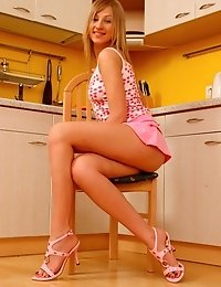 Blonde Babe With Luscious Parts Is Ready To Bring You On Cloud Seven Right In The Kitchen.