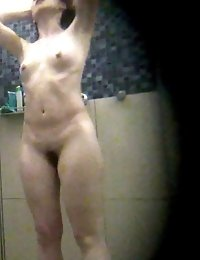 Wide hipped hairy babe shares a public bathroom